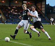 Dens Park Dundee<br /> Dundee's Kevin McDonald wins this chase with Dunfermline's Stephen Simmons