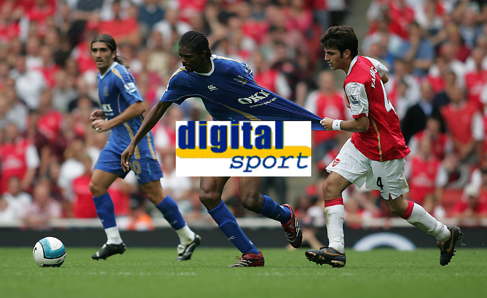 Photo: Lee Earle.<br /> Arsenal v Portsmouth. The FA Barclays Premiership. 02/09/2007.Arsenal's Cesc Fabregas (R) pulls the shirt of Portsmouth's Kanu.