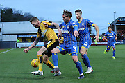 Dannie Bulman of AFC Wimbledon and Barry Corr of Cambridge United tussle during the Sky Bet League 2 match between Cambridge United and AFC Wimbledon at the R Costings Abbey Stadium, Cambridge, England on 2 January 2016. Photo by Stuart Butcher.