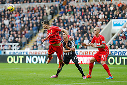 Dejan Lovren of Liverpool heads clear from Ayoze Perez of Newcastle United as Martin Skrtel of Liverpool looks on - Photo mandatory by-line: Rogan Thomson/JMP - 07966 386802 -01/11/2014 - SPORT - FOOTBALL - Newcastle, England - St James' Park - Newcastle United v Liverpool - Barclays Premier League.