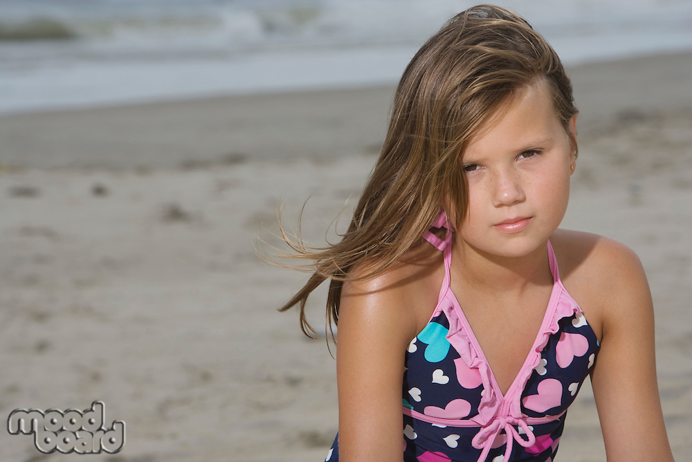 Little Girl Sitting on a Beach