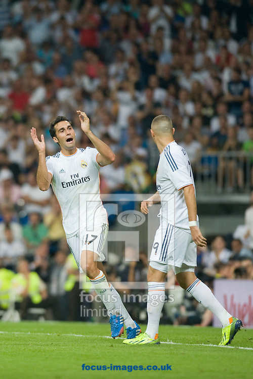 Picture by Marcos Calvo Mesa/Focus Images Ltd +34 600474871<br /> 22/09/2013<br /> Alvaro Arbeloa of Real Madrid tell fans not to be angry but support Karim Benzema during the La Liga match at the Estadio Santiago Bernabeu, Madrid.