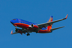 Southwest Airlines Boeing 737-7H4 (registration N265WN) approaches San Francisco International Airport (SFO) over San Mateo, California, United States of America