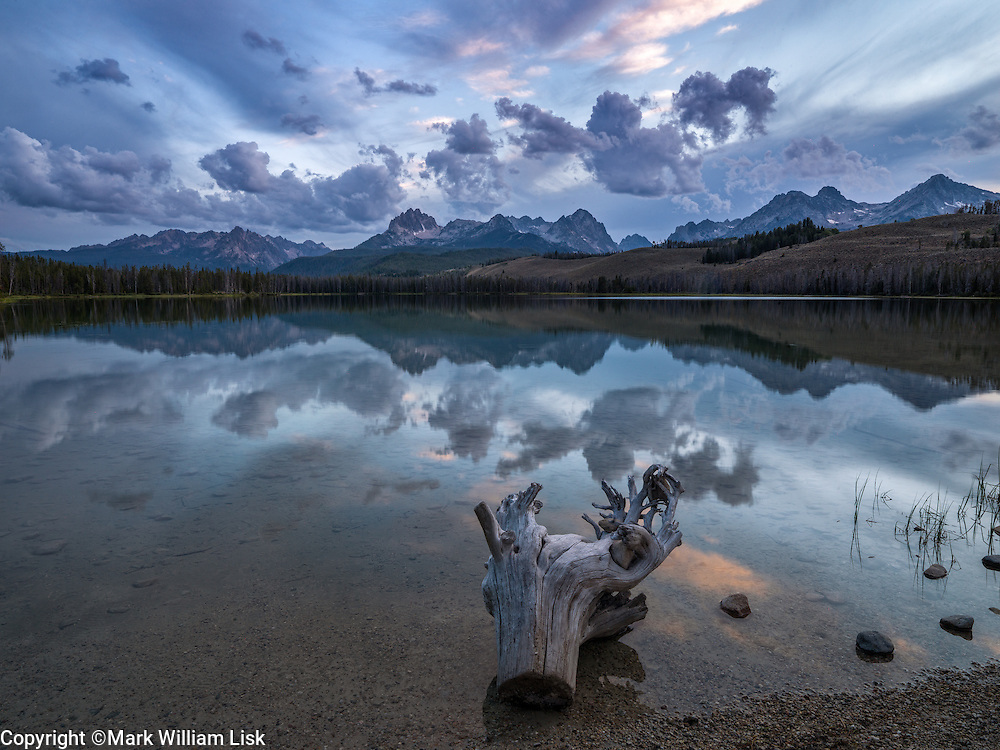 The Sawtooth Peaks reflect into Little Redfish Lake on the edge of the Sawtooth Wilderness.