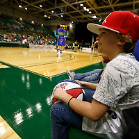 Thomas Wells | Buy at PHOTOS.DJOURNAL.COM<br /> Branten Westphall, 8, of Tupelo enjoys his front row seat to the Harlem Globetrotters show Tuesday night at the BancorpSouth Arena on Tuesday.