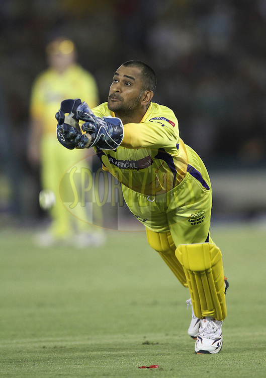 Captain MS Dhoni of the Chennai Super Kings attempts to make a diving catch during match 9 of the Indian Premier League ( IPL ) Season 4 between the Kings XI Punjab and the Chennai Super Kings held at the PCA stadium in Mohali, Chandigarh, India on the 13th April 2011..Photo by Shaun Roy/BCCI/SPORTZPICS