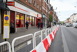 © Licensed to London News Pictures. 05/05/2020. London, UK. The pavement outside Iceland on Green Lanes, Haringey in north London is temporarily widened with barriers to help with social distancing outside shops that have outdoor queues, in high footfall areas. Photo credit: Dinendra Haria/LNP