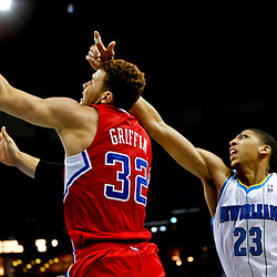 Mar 27, 2013; New Orleans, LA, USA; Los Angeles Clippers power forward Blake Griffin (32) shoots over New Orleans Hornets power forward Anthony Davis (23) during the second half of a game at the New Orleans Arena. The Clippers defeated the Hornets 105-91. Mandatory Credit: Derick E. Hingle-USA TODAY Sports