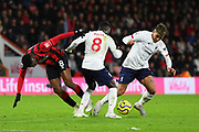 Roberto Firmino (9) of Liverpool on the attack evades Jefferson Lerma (8) of AFC Bournemouth during the Premier League match between Bournemouth and Liverpool at the Vitality Stadium, Bournemouth, England on 7 December 2019.