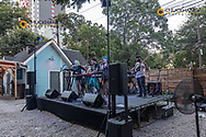 The Band Bourgeois Mystics performs at local bar along Rainey Street in downtown Austin, Texas, USA