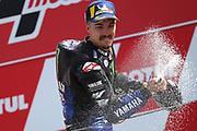 #12 Maverick Vinales, Spanish: Movistar Yamaha sprays winner champagne during the Motul Dutch TT MotoGP, TT Circuit, Assen, Netherlands on 30 June 2019.