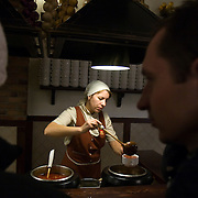 A waitress serves borscht at the Puzata Khata fastfood restaurant in Kiev, the capital of Ukraine. Borsht is a traditional Ukrainian cuisine that has spreaded via Russia throughout the former Soviet sphere.