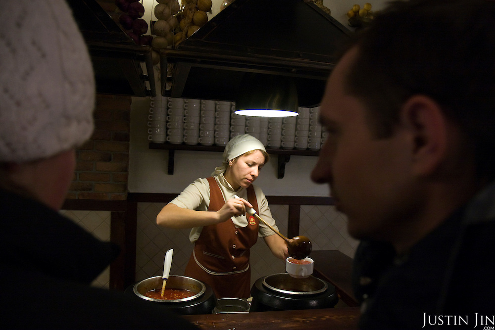 A waitress serves borscht at the Puzata Khata fastfood restaurant in Kiev, the capital of Ukraine. Borsht is a traditional Ukrainian cuisine that has spreaded via Russia throughout the former Soviet sphere.