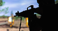 A BootCamper fires a rifle during simulated weapons training during an Honorary Commander boot camp for 40 local officials Thursday October 29, 2015 at Joint Base McGuire-Dix-Lakehurst  in Fort Dix, New Jersey. Participants experienced combined arms training, simulated combat environments and enjoyed a military cuisine. (Photo by William Thomas Cain)