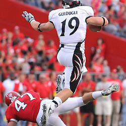 Sep 7, 2009; Piscataway, NJ, USA;  Cincinnati tight end Ben Guidugli (19) leaps over Rutgers cornerback Patrick Kivlehan (47) during the second half as Cincinnati defeats Rutgers 47-15 in NCAA Big East football at Rutgers Stadium.