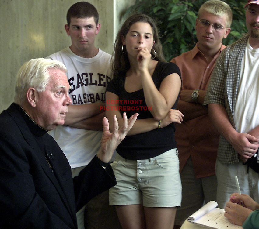 """""""Listening To Law""""       After the Mass officiated by Pope John Paul 2....Cardinal Law returned to his hotel and gave """"one on one"""" interviews with Boston area media outlets. HERE, Boston World Youth Day Pilgrims listen intently to the Q and A session."""