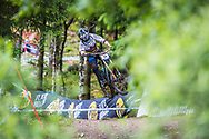 Danny Hart takes flight during his race run at the UCI Mountain Bike World Cup in Fort William.