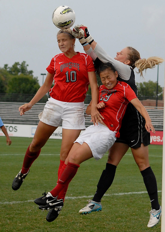 Ohio State forward Paige Maxwell (10) and midfielder Danica Wu (19) challenge University of North Carolina goalie Adelaide Gay (33) on a corner kick as OSU takes on UNC in the first half of an NCAA women's college soccer game in Columbus, Ohio on Sunday, Sept. 4, 2011, at Jesse Owens Memorial Stadium.