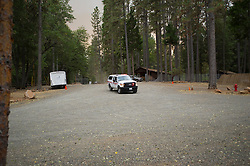 September 12, 2015 - Lake County, California, Cal Fire crew notifying staff at Hoberg's Resort to evacuate as the fire is minutes away.  (Kim Ringeisen / Polaris)