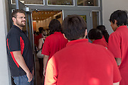 Patrick Arite holds the door while giving a campus tour on Thursday June 2, 2016. Monica Nezzer (not pictured) and Arite are both students at the University of New Mexico and are working 15-30 hours per week giving campus tours in order to help put themselves through college. (Steven St. John for NPR)