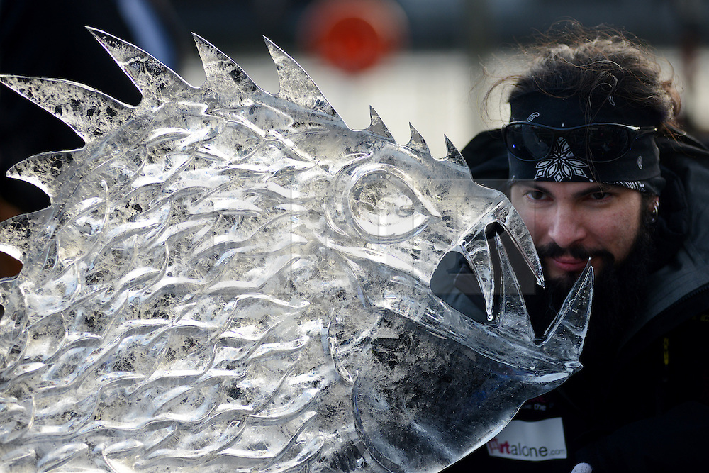 © Licensed to London News Pictures.10/01/2013. London, UK. A member of team USA creates an ice sculpture during the single block ice-sculpting competition at the London Ice Sculpting Festival in Canary Wharf.. Photo credit : Peter Kollanyi/LNP