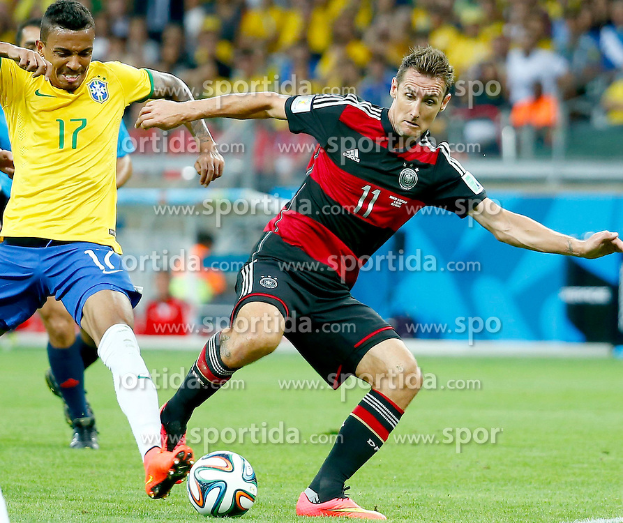 08.07.2014, Mineirao, Belo Horizonte, BRA, FIFA WM, Brasilien vs Deutschland, Halbfinale, im Bild Brazil's Luiz Gustavo vies with Germany's Miroslav Klose // during Semi Final match between Brasil and Germany of the FIFA Worldcup Brazil 2014 at the Mineirao in Belo Horizonte, Brazil on 2014/07/08. EXPA Pictures &copy; 2014, PhotoCredit: EXPA/ Photoshot/ Chen Jianli<br /> <br /> *****ATTENTION - for AUT, SLO, CRO, SRB, BIH, MAZ only*****