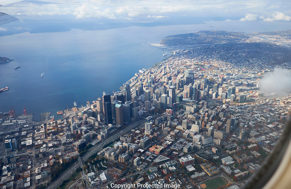 Flying over downtown Seattle with Elliott Bay visible Washington Wednesday, Nov. 1, 2017. (Photo/John Froschauer)