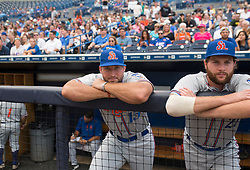 August 10, 2017 - Florida, U.S. - CHARLIE KAIJO   |   Times.St. Lucie Mets outfielder Tim Tebow (15) watches the game with teammate Michael Gibbons (21) in the dugout during a game against the Tampa Yankees at Steinbrenner Field Tampa, Fla. on Thursday, August 10, 2017. (Credit Image: © Charlie Kaijo/Tampa Bay Times via ZUMA Wire)