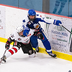 GEORGETOWN, ON - MARCH 2: Jaden Condotta #40 of the Georgetown Raiders and Nick Giunta #18 of the Markham Royals battle for a loose puck March 2, 2019 at Gordon Alcott Memorial Arena in Georgetown, Ontario, Canada.<br /> (Photo by Dave Fryer / OJHL Images)