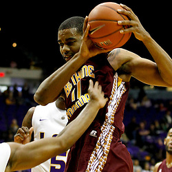 Jan 5, 2013; Baton Rouge, LA, USA; Bethune-Cookman Wildcats forward Javoris Bryant (11) rebounds over LSU Tigers guard Andre Stringer (10) during the first half of a game at the Pete Maravich Assembly Center. Mandatory Credit: Derick E. Hingle-USA TODAY Sports