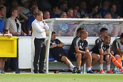 AFC Wimbledon manager Neal Ardley looking on during the EFL Sky Bet League 1 match between AFC Wimbledon and Doncaster Rovers at the Cherry Red Records Stadium, Kingston, England on 26 August 2017. Photo by Matthew Redman.