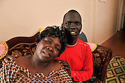 "Tucsonans, Pasca Hillary, (left), and her grandson, Okongo Majok, 21, fled Sudan and came to the United States as refugees. Hillary said that she wanted to, ""thank people who help my grandson."" She went on to explain that he has, ""no mother and father, just me."" It has been ten years since they have seen Majok's parents. Majok said, ""She is all that I have."" Majok attends the University of Arizona and plans to be an anesthesiologist."
