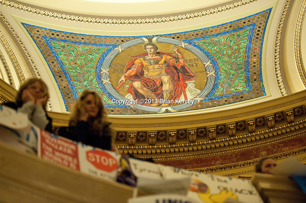 Protesters occupy the state capitol in Madison, Wisconsin on February 24, 2011. The Wisconsin budget proposed by Republican Gov. Scott Walker includes cuts in benefits for state workers and takes away many of their collective bargaining rights.   (Photo by Brian Kersey)