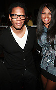 "l to r: D.L Hughley and Sandra "" Pep "" Denton at the Celebration for the Finale episode of the VH1 hit reality show ' Let's talk about Pep held at the Comix Club on March 1, 2010 in New York City."