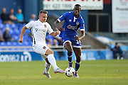 Alfie Potter of Northampton Town under pressure from Ousmane Fané during the EFL Sky Bet League 1 match between Oldham Athletic and Northampton Town at Boundary Park, Oldham, England on 16 August 2016. Photo by Simon Brady.