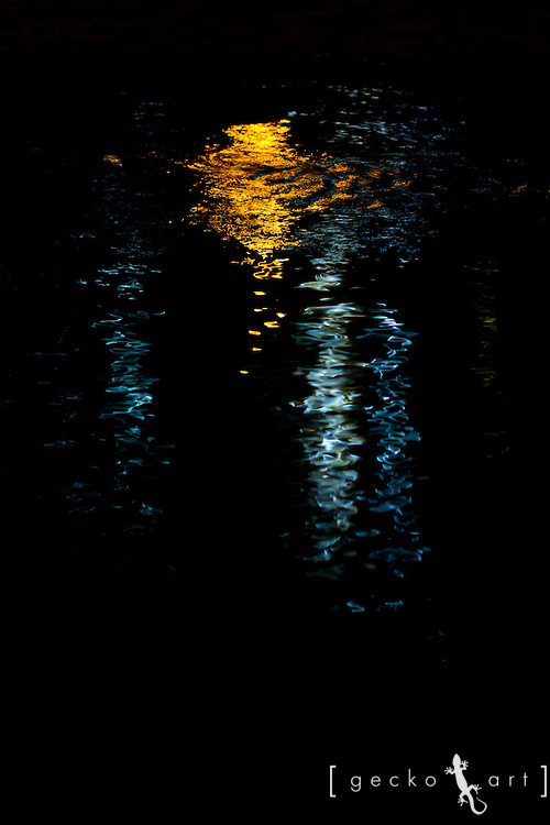 Lights reflecting off the water along a creek in Seoul, Korea