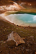 The blue sky reflects off a pool near Viti explosion crater, in the Krafla region