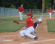 The Rays' Ken Presley scores as Cardinals' pitcher Joby Ellington makes the tag during Oxford Park Commission baseball action at FNC Park in Oxford, Miss. on Thursday, June 3, 2010.
