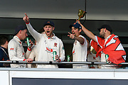 Jamie Porter of Essex and Alastair Cook of Essex celebrate on the team balcony during the County Championship title celebrations during the Specsavers County Champ Div 1 match between Somerset County Cricket Club and Essex County Cricket Club at the Cooper Associates County Ground, Taunton, United Kingdom on 26 September 2019.