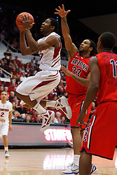 Feb 4, 2012; Stanford CA, USA; Stanford Cardinal guard Chasson Randle (5) shoots past Arizona Wildcats forward Jesse Perry (33)  during the first half at Maples Pavilion.  Arizona defeated Stanford 56-43. Mandatory Credit: Jason O. Watson-US PRESSWIRE