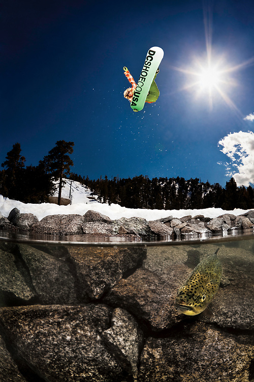 Ever since I first bought my water housing to photograph surfing, I had been looking for ways to use it for snowboarding. To create the shot I wanted I needed two key components, legit snowboard action and clear water.<br /> <br /> I started to get jobs working with Red Bull, and they would come up with these crazy ideas and then build what they wanted. This is when I realized that I could just build the components that I needed and shoot it in a semi controlled environment. <br /> <br /> I had my housing equipped with a 20 foot custom sync cord so that I could fire the strobes from under the water using a Pocket Wizard remote. When it came to lighting the scene, I knew that I would need at least one strobe to light the fish and rocks. For this, I set up a Profoto Acute 600 at full power and directed it down, right in front of me. The idea of having waterproof lights in the water was consided but I didn&rsquo;t think it would make much of a difference when considering the extra cost involved. This shot was going to be backlit so I was going to need all the fill light I could get. For this, I set up a Profoto 7b, able to fire 2 strobes. I used one with a narrow beam reflector on the left side as fill light and the other head on the right side just to help eliminate motion blur.<br /> <br /> Finally it was time to have the fish swim into the frame. I thought this was going to be easier than it was. Eventually Clayton Shoemaker jumped into the water with me to help wrangle them into position. Fish food didn&rsquo;t work. I would yell up to Lauri every time a fish was in the frame and he would drop in. After about 25 attempts we had the shot.