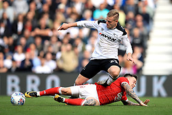 Derby County's Matej Vydra (left) and Nottingham Forest's Barrie McKay (right) battle for the ball