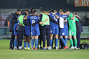 AFC Wimbledon players in a huddle during the EFL Sky Bet League 1 match between AFC Wimbledon and Southend United at the Cherry Red Records Stadium, Kingston, England on 24 November 2018.