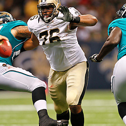 August 17, 2012; New Orleans, LA, USA; New Orleans Saints defensive end Akiem Hicks (76) rushes the quarterback against the Jacksonville Jaguars during the second half of a preseason game at the Mercedes-Benz Superdome. The Jaguars defeated the Saints 27-24.  Mandatory Credit: Derick E. Hingle-US PRESSWIRE