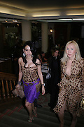 Sheetal Mafatlal and Valentina Drouin. 4 Inches, A  Photographic Auction in aid of the Elton John Aids Foundation hosted by Tamara Mellon and Arnaud Bamberger. Christie's. 8 King St. London. 25 May 2005. ONE TIME USE ONLY - DO NOT ARCHIVE  © Copyright Photograph by Dafydd Jones 66 Stockwell Park Rd. London SW9 0DA Tel 020 7733 0108 www.dafjones.com