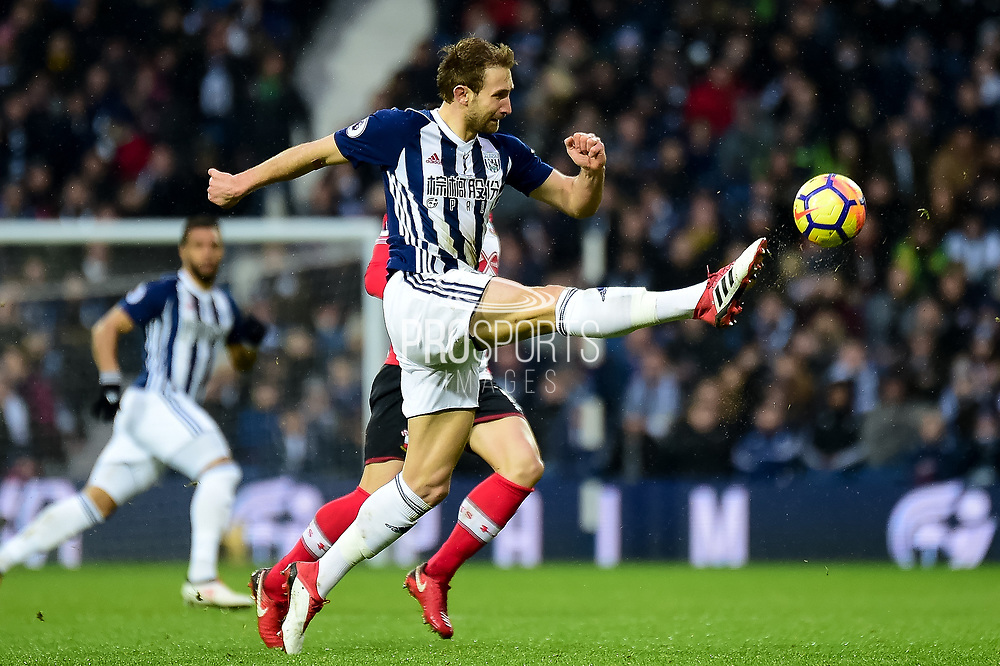 West Bromwich Albion defender Gareth McAuley (23) clears his lines during the Premier League match between West Bromwich Albion and Southampton at The Hawthorns, West Bromwich, England on 3 February 2018. Picture by Dennis Goodwin.