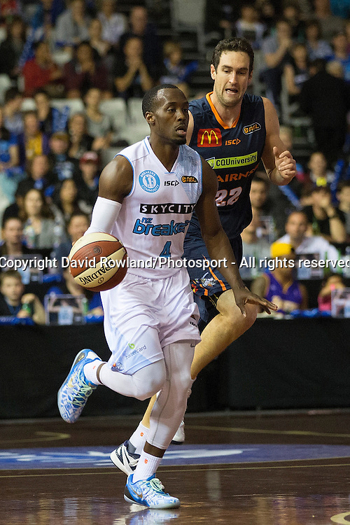 Breakers` Cedric Jackson runs past Taipans` Matt Burston in the SkyCity Breakers v Cairns Taipans, 2014/15 ANBL Basketball Season, North Shore Events Centre, Auckland, New Zealand, Thursday, October 23, 2014. Photo: David Rowland/Photosport