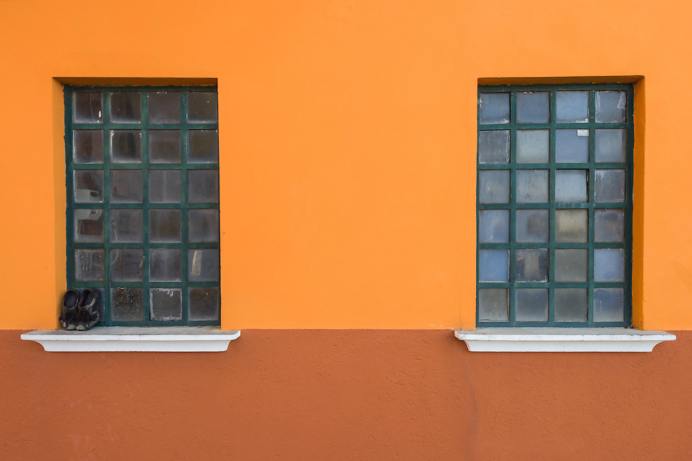 walls of traditional houses in burano are painted in bright colours