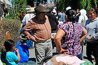 Tereso Zarate, 68, talks with friends at a Monterey County Food Bank distribution program in the Hebbron neighborhood where he lives. He is a field worker from Oaxaca, Mexico who cannot subsist solely on seasonal work as a lettuce-picker.