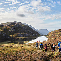 A photograph of a walking group on haystacks near Buttermere in the Lake District, Cumbria, England.